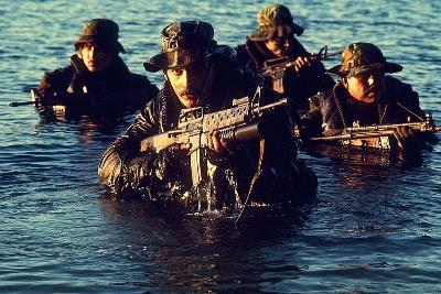 US Navy SEAL Team Emerges from Water During Warfare Training, Dec. 1, 1986--Photo