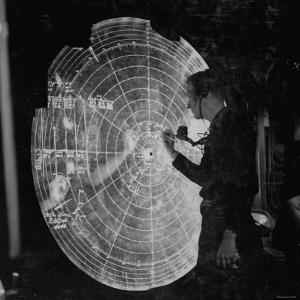 US Navy Technician Marking Radar Data on Chart, Tracking Enemy Japanese Ships in WWII Pacific
