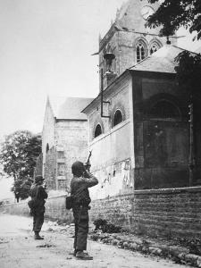 Us Paratrooper Fires into Church Steeple at Sainte Mere Eglise to Clear Enemy Sniper, 6th June 1944