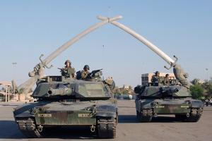 US Tanks Drive under the 'Hands of Victory' in Baghdad, Iraq, Ca. 2003
