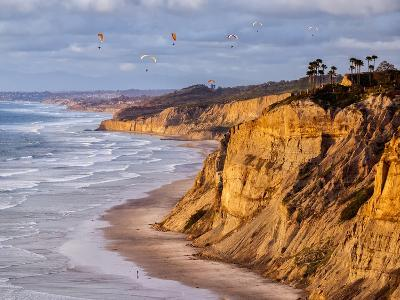 USA, California, La Jolla. Paragliders Float over Black's Beach in Late Afternoon-Ann Collins-Photographic Print
