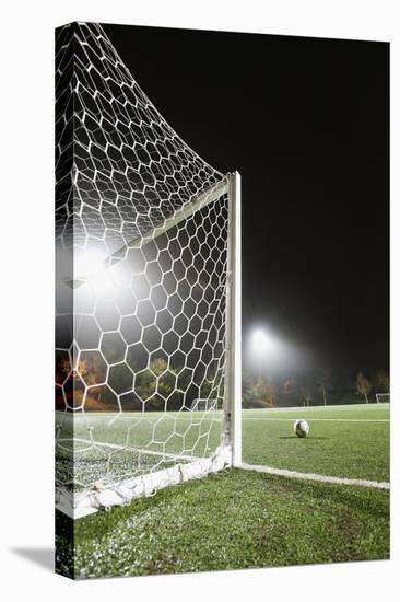 Usa, California, Ladera Ranch, Football in Front of Goal-Erik Isakson-Stretched Canvas Print