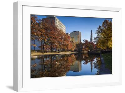 USA, Connecticut, Hartford, Bushnell Park, reflection of office buildings and Travelers Tower-Walter Bibikow-Framed Premium Photographic Print