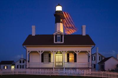 USA, Georgia, Tybee Island, Flag flying on lighthouse at Tybee Island.-Joanne Wells-Photographic Print