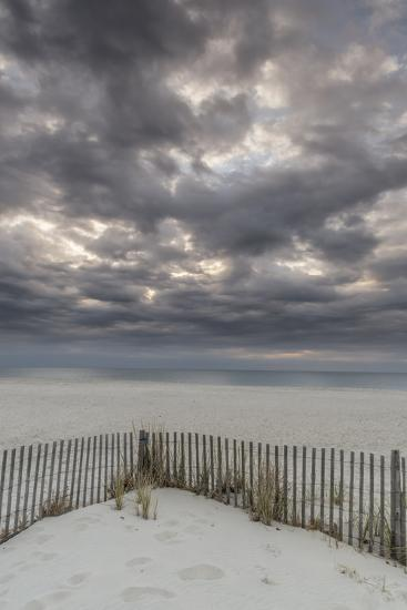 USA, New Jersey, Cape May National Seashore. Beach fence and stormy sunrise.-Jaynes Gallery-Photographic Print
