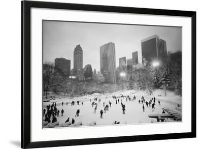 USA, New York, New York City, Skaters at the Wollman Rink-Walter Bibikow-Framed Photographic Print