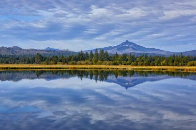 USA, Oregon. Clouds Reflect in Small Lake at Black Butte Ranch-Jean Carter-Photographic Print