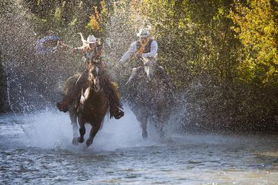 https://imgc.artprintimages.com/img/print/usa-wyoming-shell-the-hideout-ranch-cowboy-and-cowgirl-on-horseback-running-through-the-river_u-l-q1d2bfq0.jpg?p=0