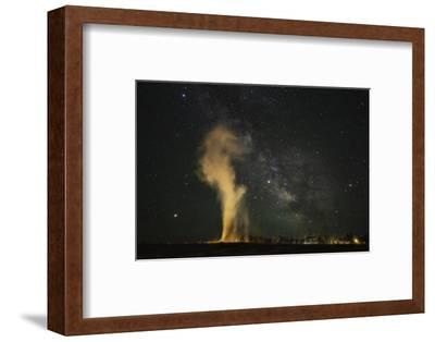 USA, Wyoming, Yellowstone NP. Milky Way and erupting Old Faithful Geyser.-Jaynes Gallery-Framed Photographic Print