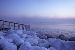 Icy Morning at the LŸbeck Bay in TravemŸnde, Iced Up Stones, Stairs, Morning Mood by Uwe Steffens