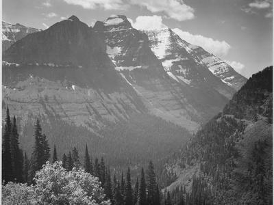 https://imgc.artprintimages.com/img/print/valley-snow-covered-mountains-in-background-in-glacier-national-park-montana-1933-1942_u-l-q19qj6a0.jpg?p=0