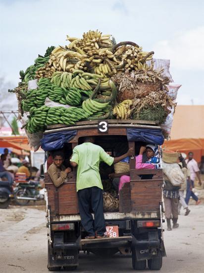 Van Loaded with Bananas on Its Roof Leaving the Market, Stone Town, Zanzibar, Tanzania-Yadid Levy-Photographic Print
