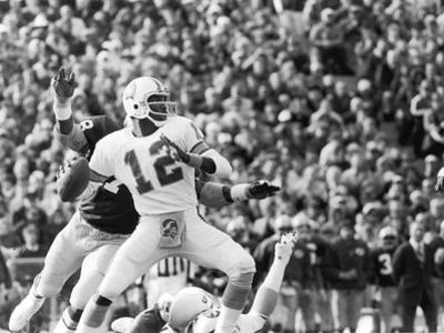 Doug Williams,  Throws a Long Pass, 1979 by Vandell Cobb