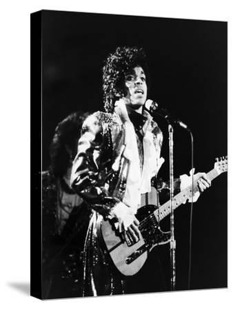 Prince, Rocks the Stage During His Purple Rain Tour in 1984