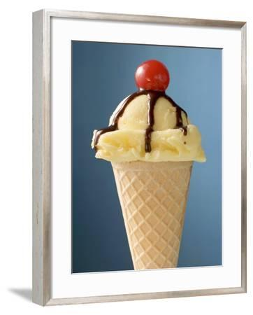 Vanilla Ice Cream Cone with Chocolate Sauce and Cocktail Cherry--Framed Photographic Print