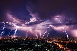 Lightning Storm over City in Purple Light by Vasin Lee