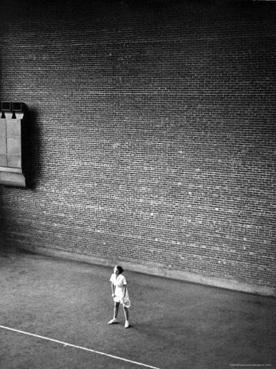 Vassar Student Waiting to Receive a Serve While Playing Indoor Tennis on Campus at Vassar College-Alfred Eisenstaedt-Photographic Print
