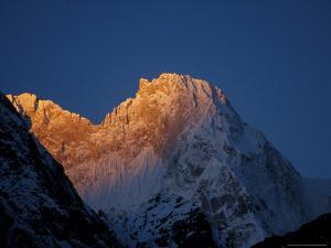 Sunrise on Chomolonzo, Tibet by Vassi Koutsaftis