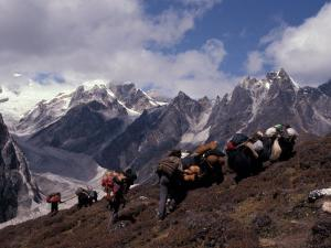 Yak Drivers Above the Kangshung, Tibet by Vassi Koutsaftis