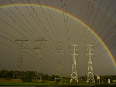 Vast Array of Electrical Towers and Cables Beneath a Huge Rainbow-Jason Edwards-Photographic Print