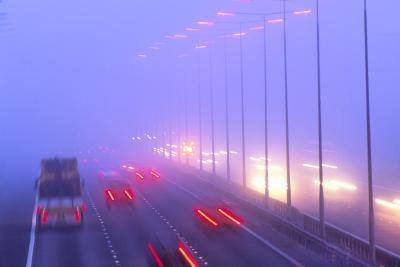 Vehicles Driving Through Fog on a Motorway-Jeremy Walker-Photographic Print