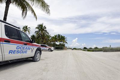 Vehicles of the ocean rescue in the lummus park ocean drive art
