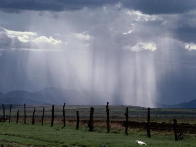 Veils of Rain Stream from Sunlit Clouds over Farmland-George Grall-Photographic Print