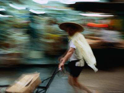 Vendor Pushing His Cart Through a Market, Hong Kong, China-Michael Coyne-Photographic Print