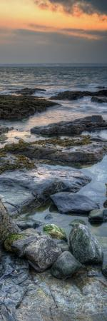 Vertical Panorama Landscape of Rocky Coastline at Sunrise