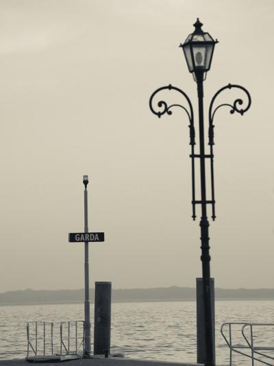 Veneto, Lake District, Lake Garda, Garda, Lakeside Pier View, Italy-Walter Bibikow-Photographic Print