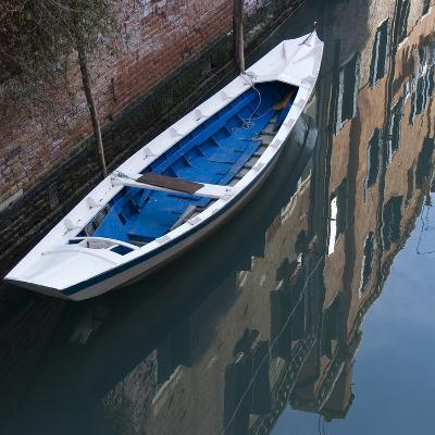 Venice Sense of Place. Blue and White Boat on Canal-Mike Burton-Photographic Print