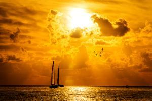 Sailboat and Disherman at Sunset by vent du sud