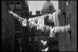 Laundry on Line in Slum Area in New York City by Vernon Merritt III