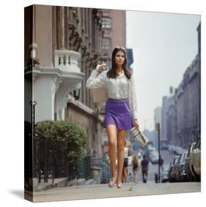 """Long Hair Woman with short skirt, lace top and sandals walking up street in """"New York Look"""" fashion by Vernon Merritt III"""