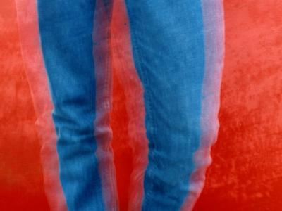 Vibrant Blue Jeans against a Red Background-Raymond Gehman-Photographic Print