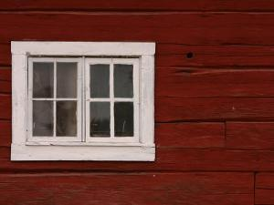 Vibrant Red Painted Barn Wall with White Window