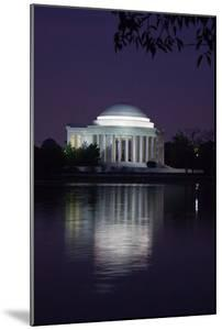 The Jefferson Memorial and its Illuminated Reflection Cast on the Tidal Basin at Dusk by Vickie Lewis