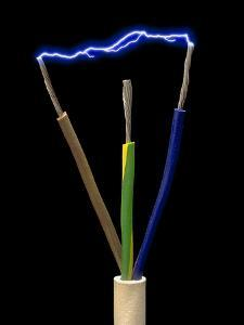 Wires of a 3-pin Plug Showing Spark Discharge by Victor De Schwanberg