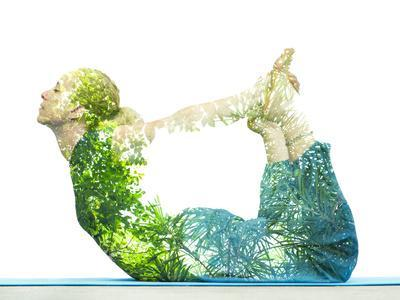 Combining Nature with Spiritual Yoga in a Creative Portrait of a Young Woman Lying with Her Body Ar