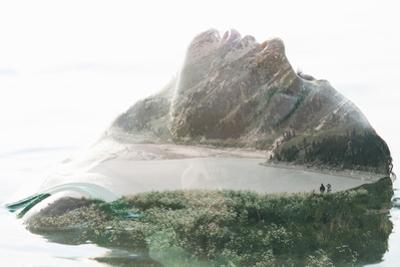 Double Exposure Portrait of Attractive Woman Combined with Photograph of Lake Surrounded by Mountai by Victor Tongdee