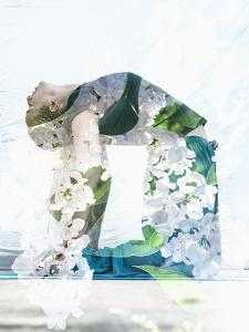 Double Exposure Portrait of Attractive Woman Performing Yoga Asana Combined with Photograph of Lila by Victor Tongdee