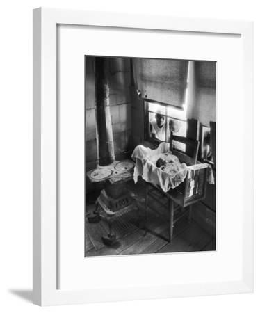 Victoria Cooper's Children Peering in Window Where Newborn Baby Lies in Crib Made from Fruit Crate-W. Eugene Smith-Framed Photographic Print