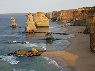 Victoria, Some of Twelve Apostles Standing in Shallow Water, Port Campbell National Park, Australia-Nigel Pavitt-Photographic Print