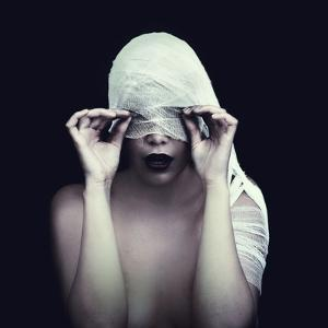 Woman in Bandage over Black Background by viczast