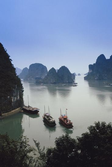Vietnam, Halong Bay, Tourist Boats Anchor at the Cave of Marvels-Walter Bibikow-Photographic Print