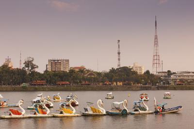 Vietnam, Hue. Perfume River and Tourist Swan Boats, Sunset-Walter Bibikow-Photographic Print