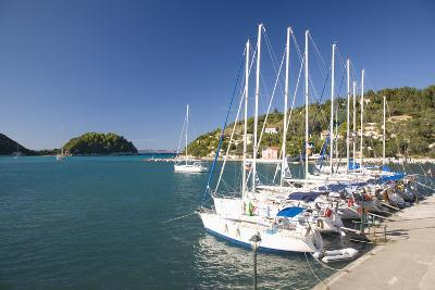 View across Lakka Bay, Yachts Lined Up Along the Quay, Lakka-Ruth Tomlinson-Photographic Print