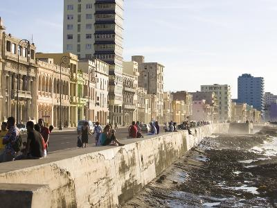 View Along the Malecon, People Sitting on the Seawall Enjoying the Evening Sunshine, Havana, Cuba-Lee Frost-Photographic Print