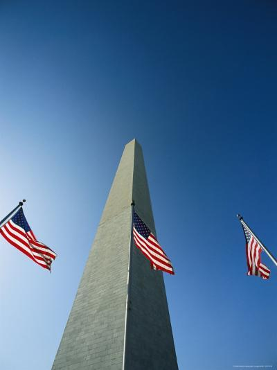 View from the Ground of the Washington Monument and American Flags-Kenneth Garrett-Photographic Print