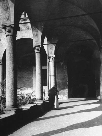 View of a Monk Walking the Grounds of a Church in Milan-Carl Mydans-Photographic Print